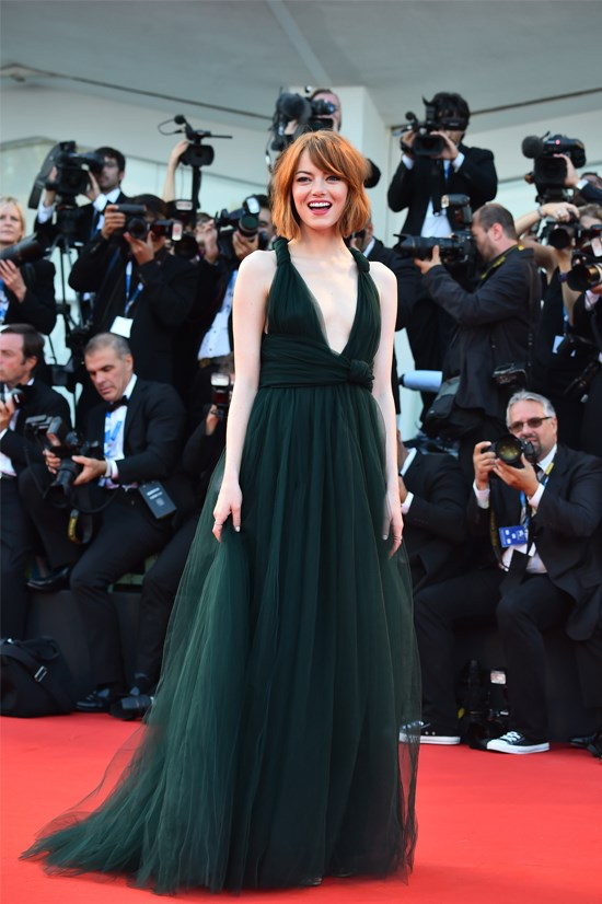 "Emma Stone wearing Valentino Couture at the Opening Ceremony and premiere of ""Birdman"" at the 71st Venice Film Festival."