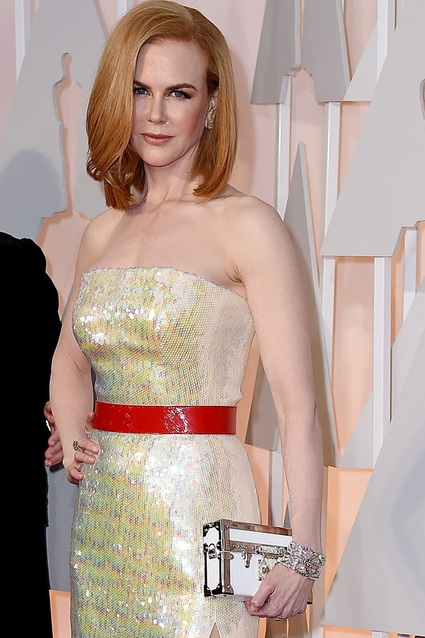 Nicole Kidman's accessories this year included a very chic Louis Vuitton box clutch and Harry Winston jewellery.
