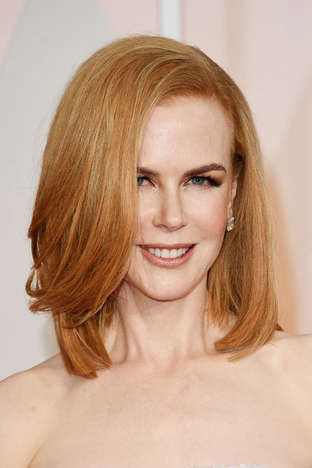 <p><strong>The Smoky Eye</strong></p> Nicole Kidman accentuated her fresh red hair with a warm toned shadow.