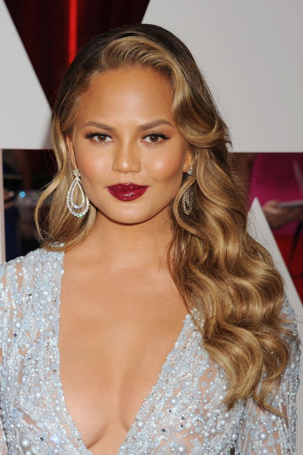 """""""Chrissy Teigen reinvented old Hollywood glamour on the red carpet at this year's Oscars. The long cascading waves, the tonal ombre hair colour and the divine shine was a standout."""""""