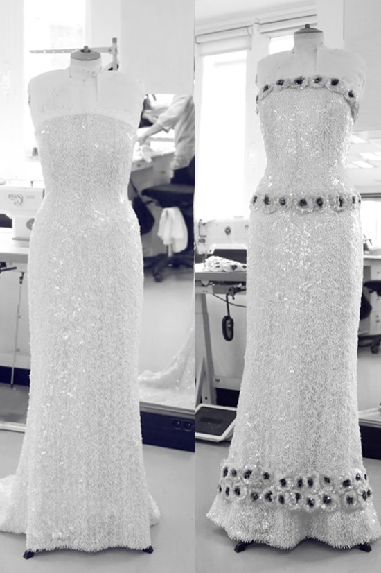 In Paris, the dress was assembled by 4 seamstresses in 215 hours.