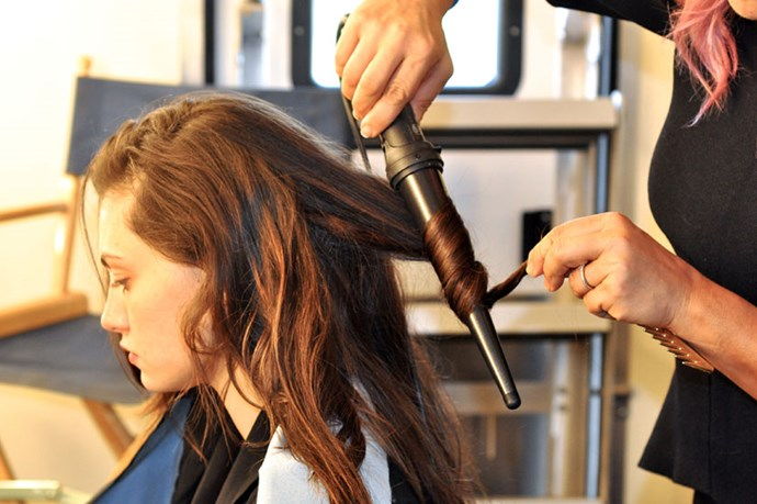 <p><strong>Step 3:</strong> Holding the Cloud Nine Large Wand vertically to the hair, wrap random sections of hair in varying amounts around the wand. Make sure to only curl from the mid lengths to the ends – you don't want the waves and texture to start until its level with the ears, downwards.</p>