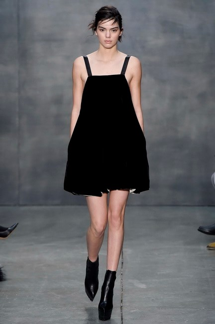Kendall Jenner walks for Vera Wang in this LBVD (little black velvet dress).