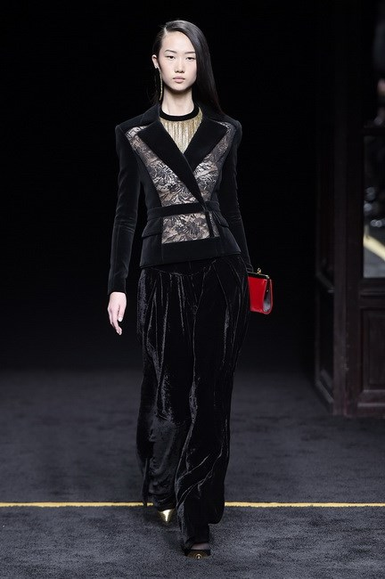 At Balmain, the material was used in this pantsuit and in the soft accessories.