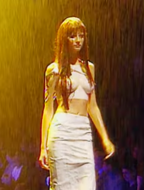 """<strong>Alexander McQueen Spring/Summer 1998</strong><br> This rain-soaked show was Gisele's first big break—afterwards, McQueen dubbed her """"The Body."""" Not hard to see why..."""