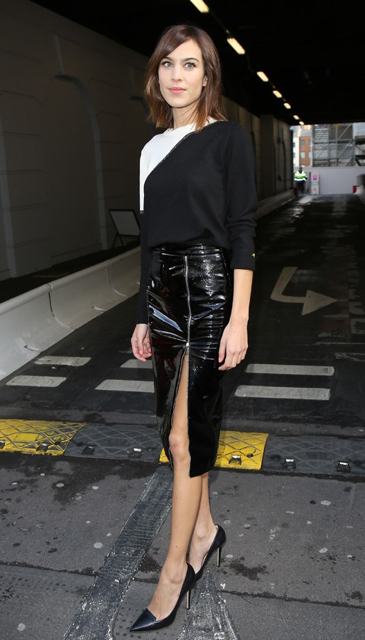 Alexa Chung at Christopher Kane AW15-16 show at London Fashion Week wearing a Christopher Kane PVC zip pencil skirt