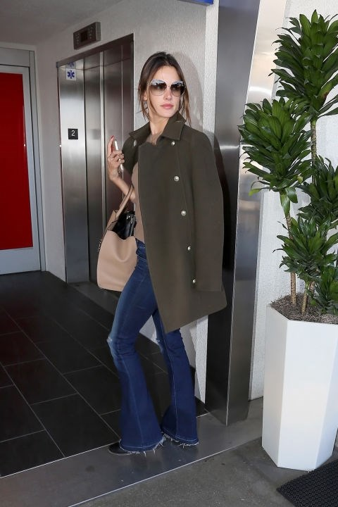 <strong>ALESSANDRA AMBROSIO</strong> <BR> The Victoria's Secret model pairs a loose open coat perfectly with skinny flare jeans.