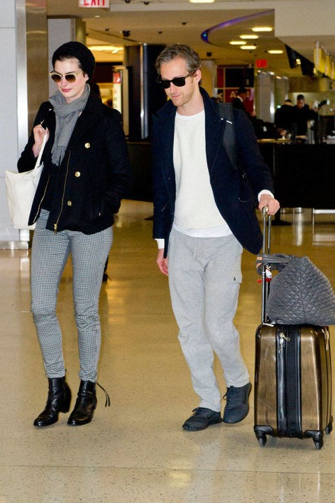 <strong>ANNE HATHAWAY</strong> <BR> Casual gray and black separates work for both the Oscar winner and her hubby.