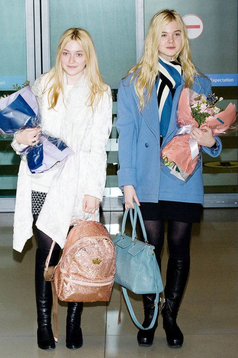 <strong>ELLE AND DAKOTA FANNING</strong> <BR> These stylish sisters' oversized coats and pale-hued bags are a refreshing change from standard black airport attire. Note that these coats are nice and roomy for extra comfort and an extra layer on that freezing cold plane.
