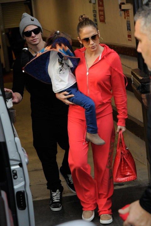 <strong>JENNIFER LOPEZ</strong> <BR> It seems J. Lo will stay forever true to the sweatsuit—but here she takes it up a notch with a matching cherry red bag.