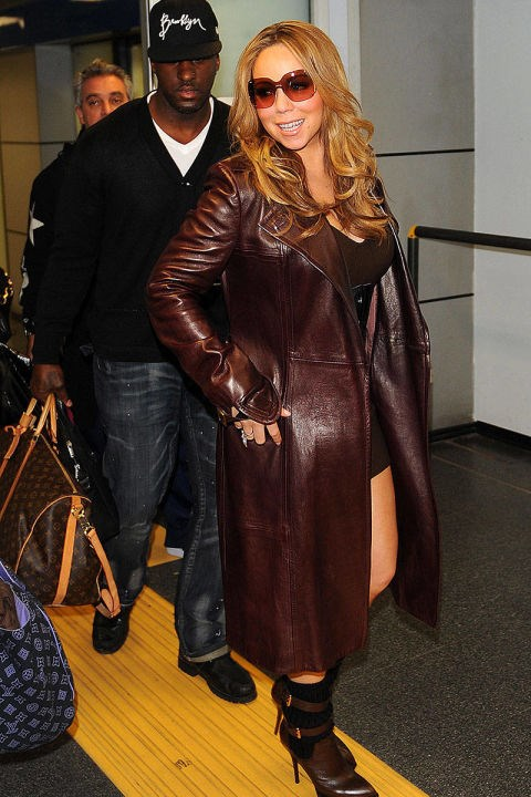 <strong>MARIAH CAREY</strong> <BR> A long leather coat is the ultimate in luxe travel wear.