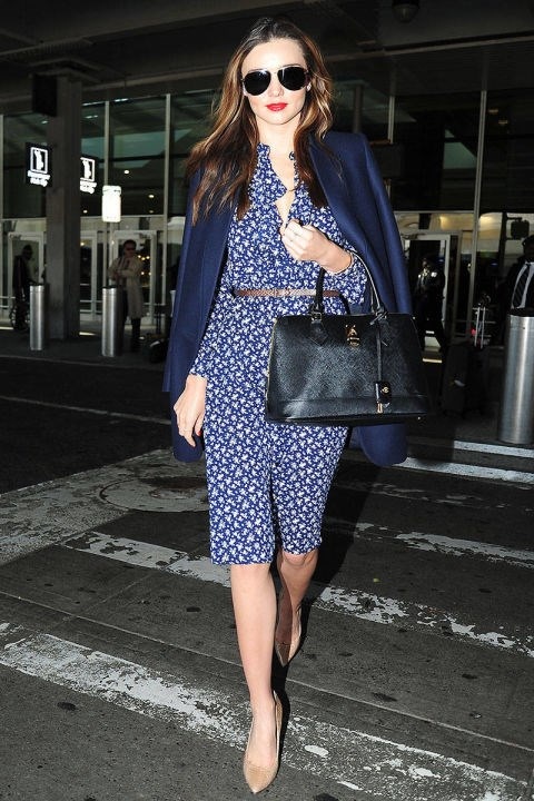 <strong>MIRANDA KERR</strong> <BR> A ladylike dress, matching coat, and bold red lip will ensure you're ready to go anywhere as soon as you land.