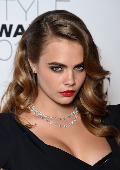 Swoop your front piece of hair to the side, like Cara Delevingne