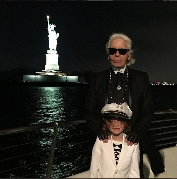 Karl Lagerfeld and Hudson Kroenig <br><br> Source: @caradelevingne