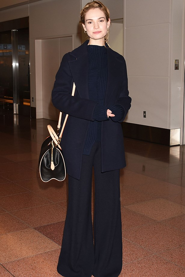 <em>Cinderella</em> star Lily James is becoming every bit an it-girl with her latest looks. This understated, all-navy outfit (and of course, the flares!) is the perfect combination of fashion and function for those long layovers.