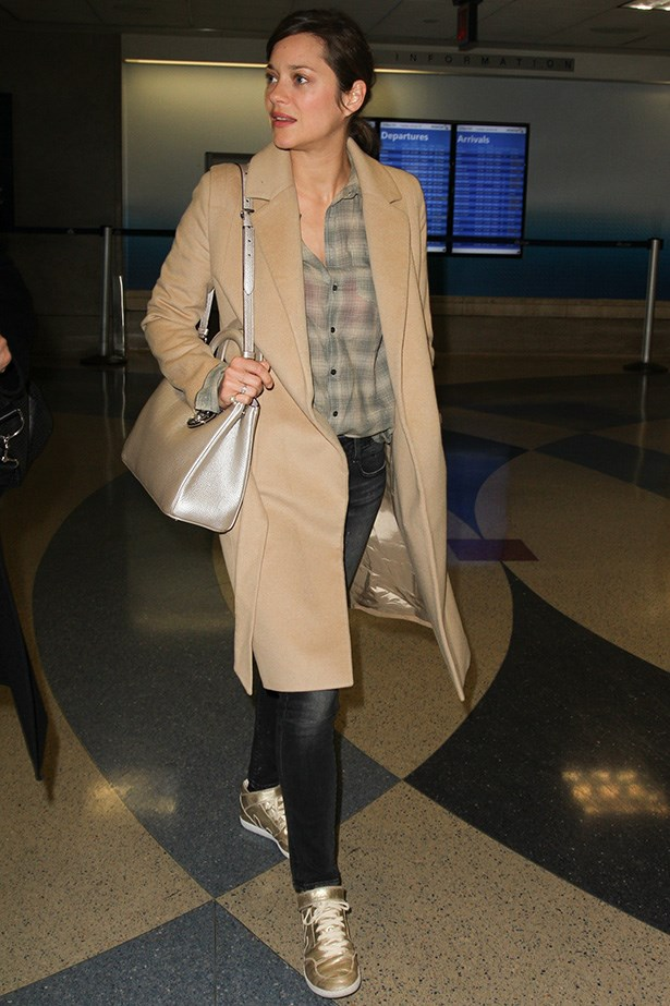 Marion Cotillard sure doesn't play games – who needs heels on an 18-hour flight when you can whip out the cushioned high top sneakers?