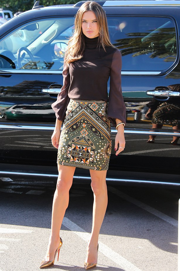 Alessandra Ambrosio proves that a roll neck and a skirt is the ultimate cross-seasonal evening look.