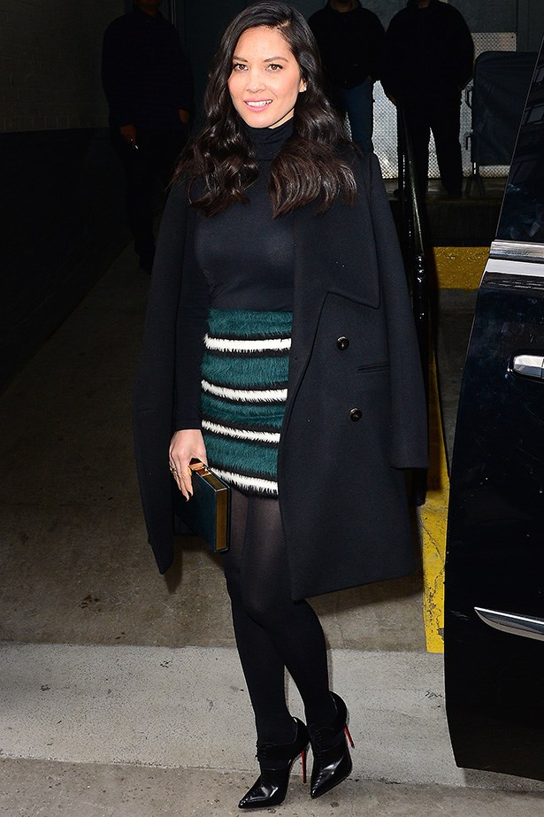 Take a leaf from Olivia Munn's sartorial book and be sexy without showing any skin at all. Simply select quality stockings and a fitted roll neck - plus anything black - to showcase your best features in a sophisticated way.