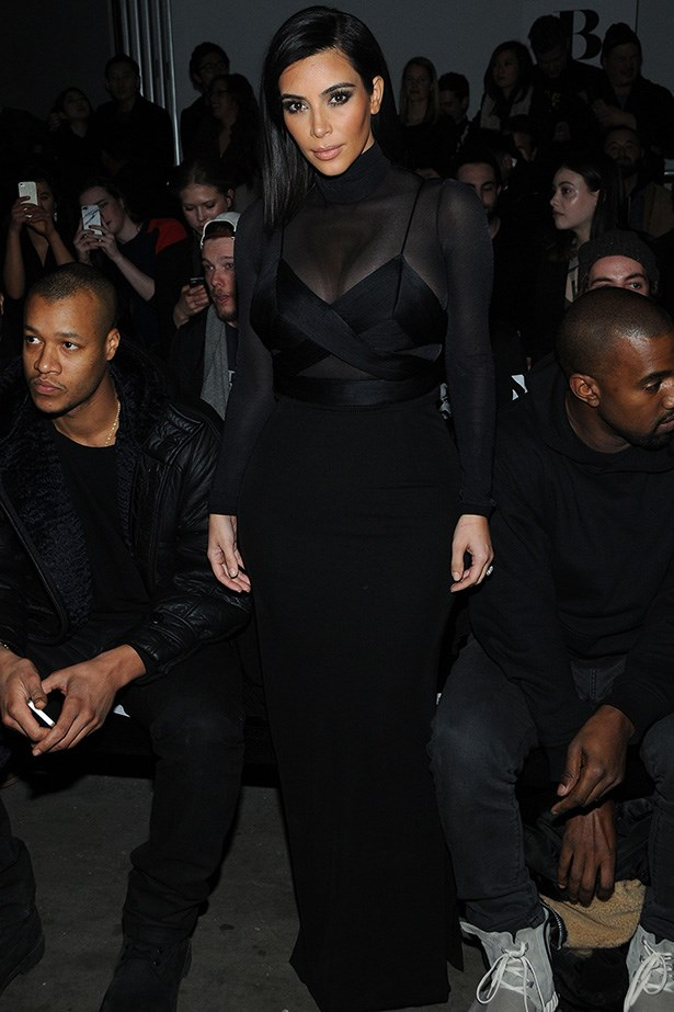 Kim Kardashian opts for an Olivia Munn no-skin approach: a bevy of black threads, sheer fabric where needed and oh yes, one very elegant roll neck.