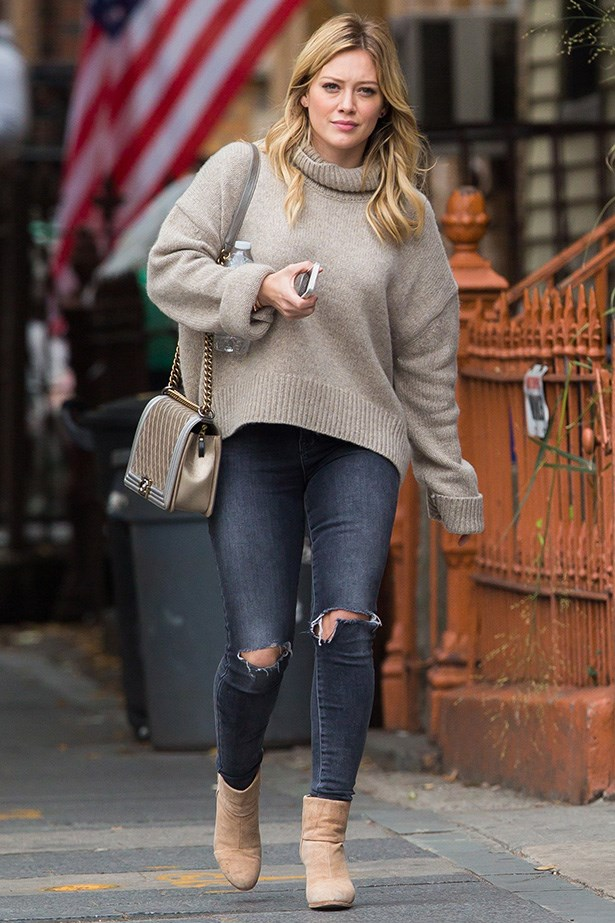 While we've mainly been fawning over form-fitting roll necks, Hilary Duff looks cozy as can be - without sacrificing style - in a looser version of the trending top.