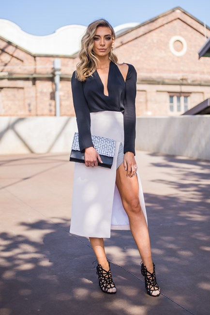 Nadia Bartel - Top: Dion Lee, Skirt: Christopher Esber, Bag: Proenza Schouler