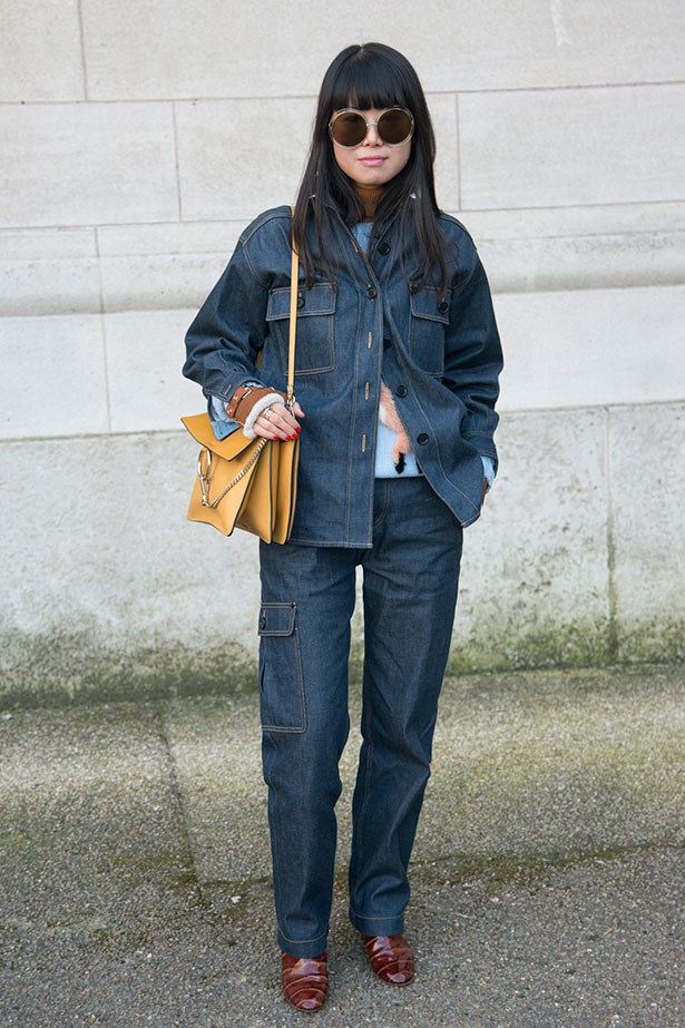 Leaf Greener wears a Chloe bag and sunglasses at the Chloe show for PFW 2015.