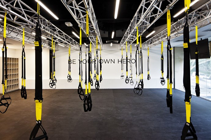 """<p><strong>TRX Circuit</strong></p> <p>Suspension resistance training with a cardio twist</p> <p><strong>Overview:</strong> """"TRX"""" stands for """"Total Body Resistance Exercise"""". Using a single piece of equipment made from two nylon straps suspended from the ceiling, TRX leverages gravity and body weight to perform hundreds of strength-training exercises, from push-ups to planks.</p> <p><strong>Verdict:</strong> This class combines TRX with cardio drills in 60- to 90-second intervals, which seemed achievable since the theory behind a """"circuit"""" workout is that it allows for a recovery period between exertions. But in this case, said """"recovery"""" involved countless chest presses, tricep dips and bicep curls using the TRX straps. Needless to say, the hour-long session kicked my butt. This class is ideal for advanced athletes looking for a strengthening alternative to standard dumbbells.</p> <p><em><a href=""""http://www.flowathletic.com.au/"""">flowathletic.com.au</a</em></p>"""