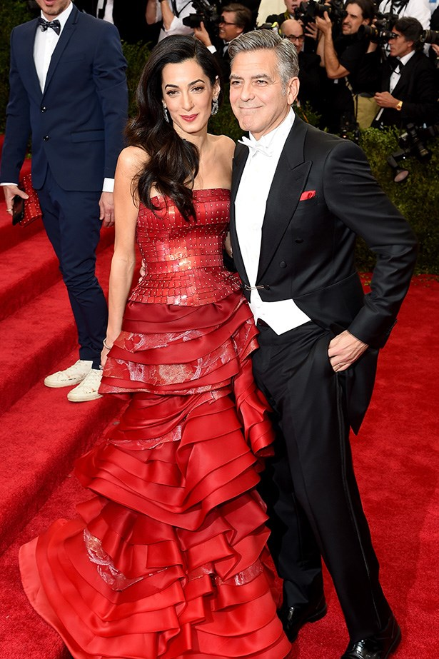 Amal Clooney in Maison Margiela with George Clooney in Armani