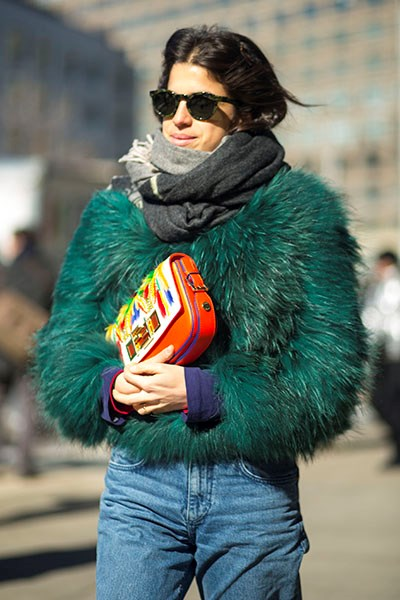"""""""A textured jacket and pop clutch instantly elevates a pair of classic boyfriend jeans. """""""