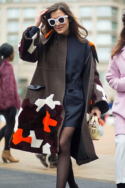"""""""I love a white accessory at the moment and these sunglasses are a spot-on match with her quirky coat."""""""