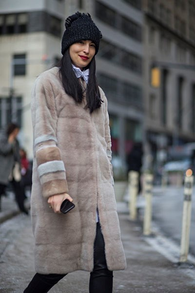 """""""A classic coat looks super-cool worn back with a pussybow blouse and beanie."""""""
