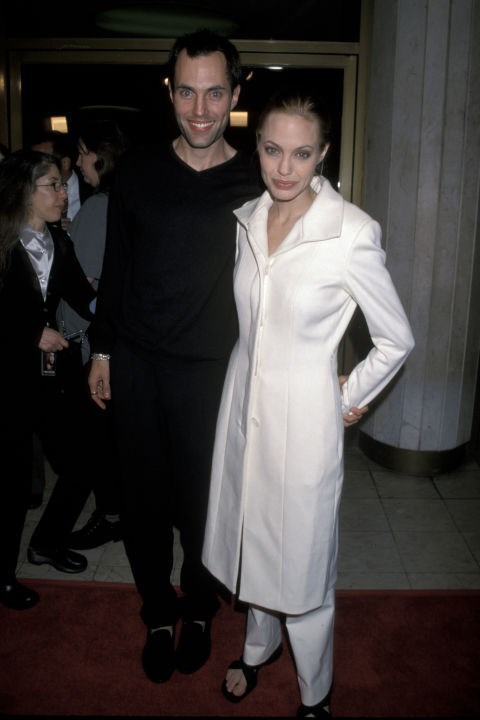 Early signs of her signature minimalist style? With her brother, James Voight, at a screening of <em>The Bone Collector</em> in November 1999.