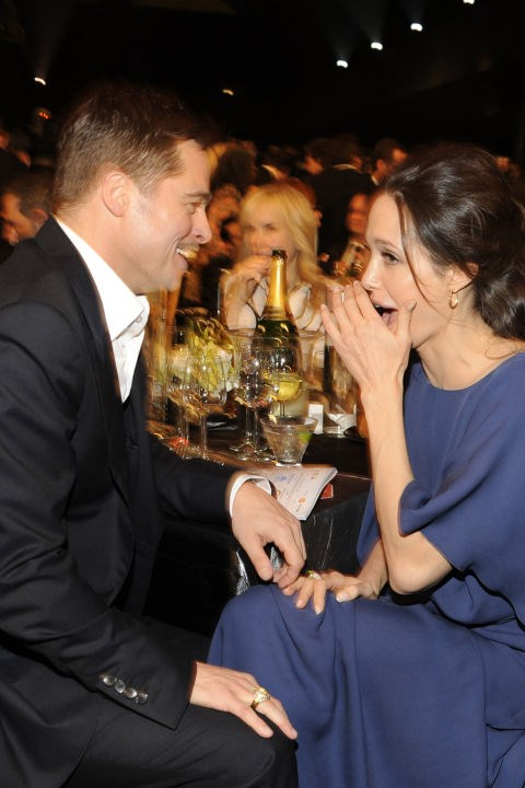 Whispering to Brad Pitt at the 2009 Screen Actors Guild awards.