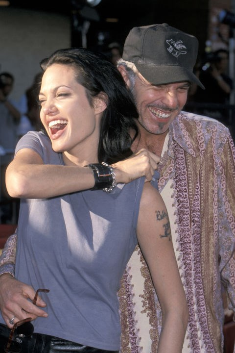 Giggling with then husband Billy Bob Thornton at the <em>Gone in 60 Seconds</em> premiere in June 2000.