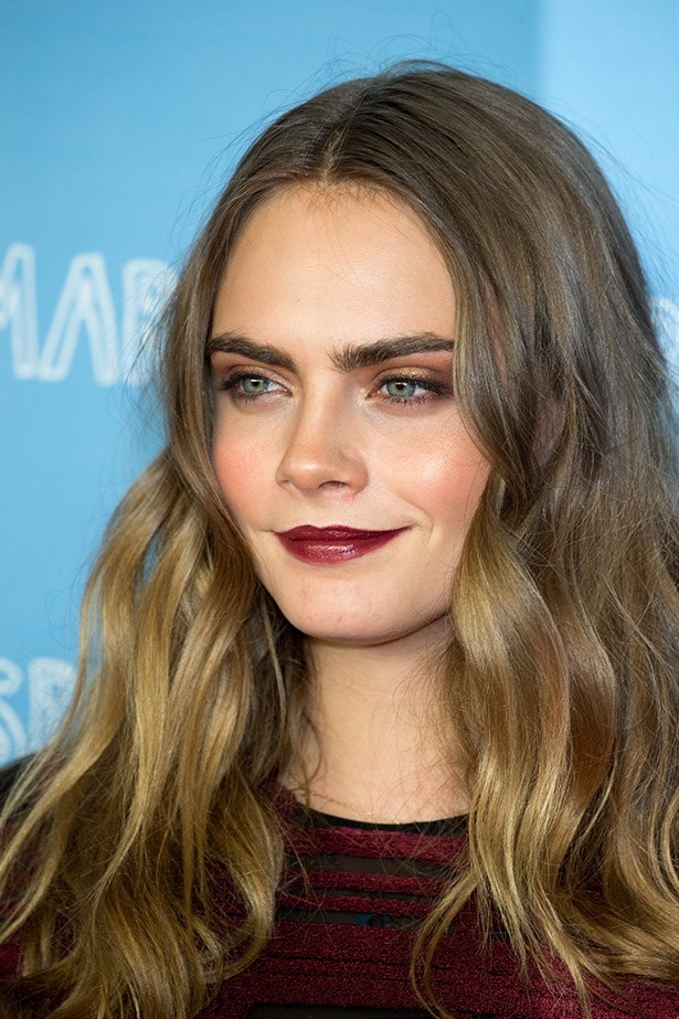 Let's zoom in on Cara's cherry red lips.