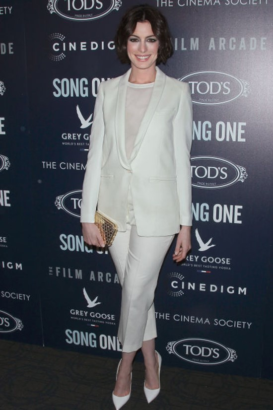 <strong>ANNE HATHAWAY</strong> <BR> Instead of going sans top for a full-on plunge, Hathaway looks to a sheer tee to layer beneath her ivory suit for a look that's sophisticated and streamlined.