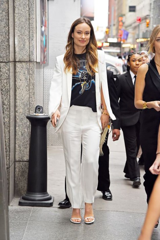 <strong>OLIVIA WILDE</strong> <BR> Looking to a T-shirt yet again, the star wears her graphic style with a sharp white cape, loose-fitting trousers, and white sandals. It's like the perfect combo of runway and rock 'n' roll.