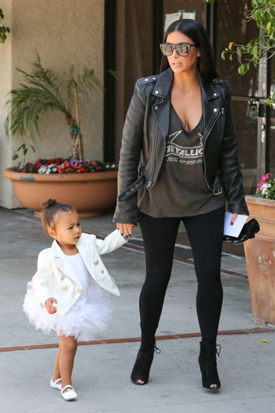 <strong>KIM KARDASHIAN</strong> <BR> Kardashian rethinks the classic band T-shirt by looking to a style with a slouchy silhouette that shows off her ample cleavage. She tones down the sexy by wearing it with a heavy motorcycle jacket, leggings, and lace-up peep toe heels.