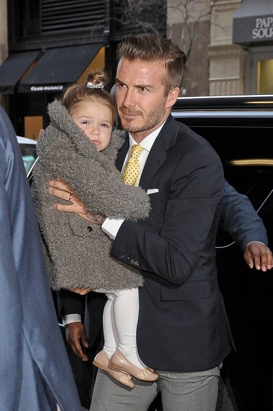 Heading to mum Victoria Beckham's fashion show with dad David in New York.