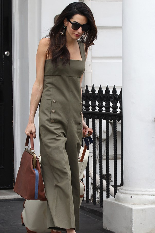Amal Clooney nee Amal Alamuddin exiting her London apartment in a green jumpsuit
