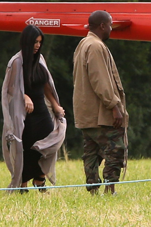 Kim and Kanye arriving by helicopter. Standard.