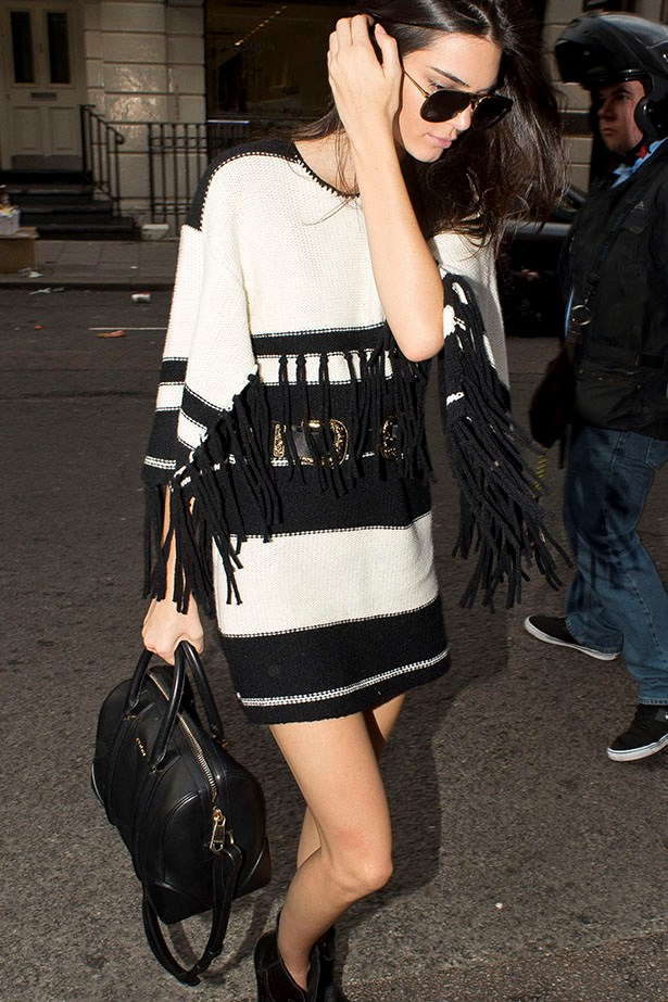Kendall Jenner has us longing for a sweater dress, especially one just like this Alice McCall number (!) with fringing that we can work back with ankle boots (and tights) this winter. It's like, fancy boho.