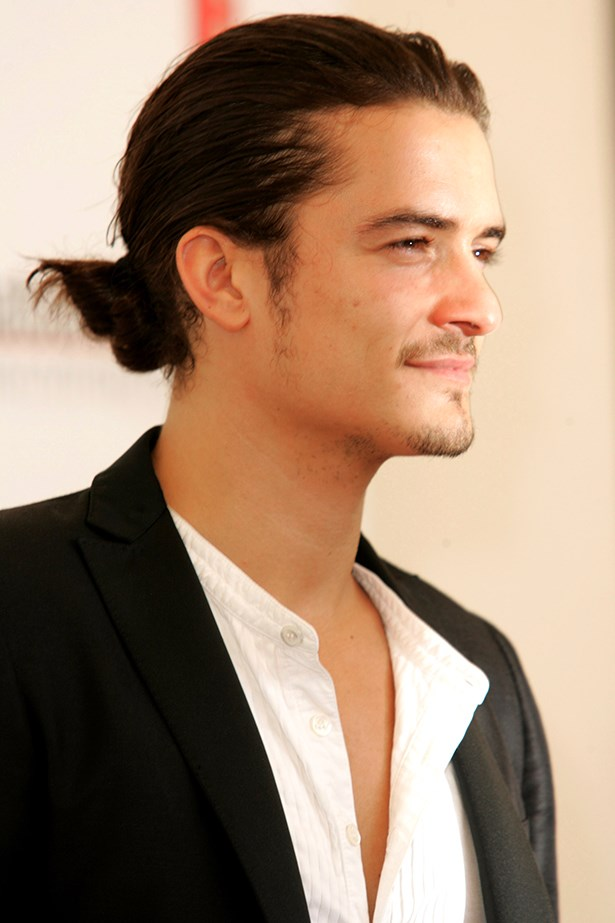 Portrait of Orlando Bloom with ponytail.