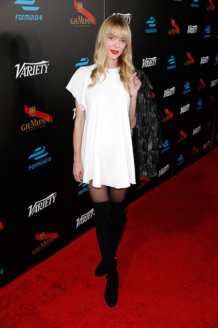 Jaime King shows us how it's done with a fresh white shift and black boots. Heaven.