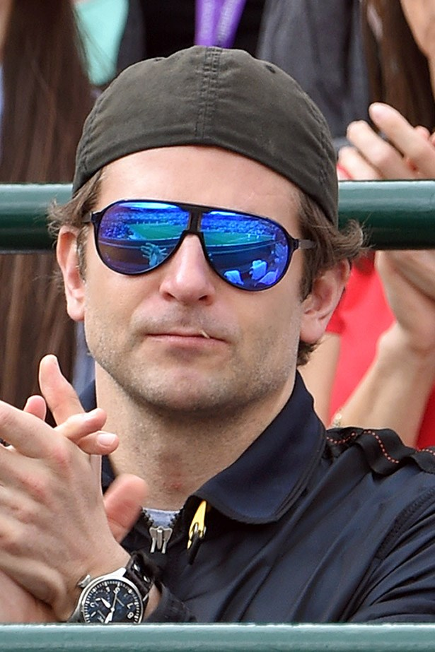 Bradley Cooper clearly knows a lot about sport because he has a toothpick in his mouth.