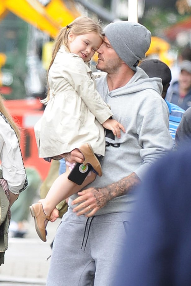 Out in London in one shoe with dad David Beckham.