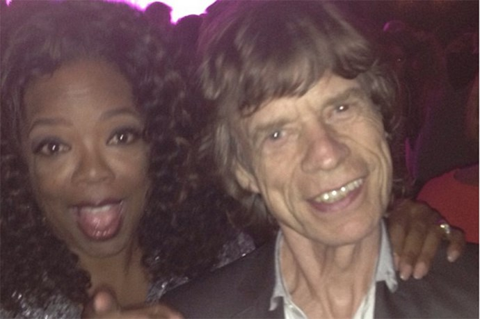 Even OPRAH fangirls. She posted this snap of herself with Mick Jagger to Instagram with the caption, , 'My first time meeting Mick Jagger! And yes he dances like Mick Jagger!'