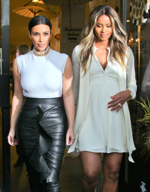 KIM KARDASHIAN AND CIARA. Paris Fashion Week dress-up friends.