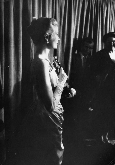 Backstage at the Academy Awards, holding her Oscar for Best Actress, on March 30, 1955.