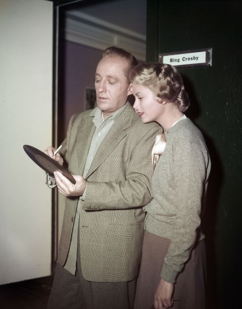 Bing Crosby signing one of his records for her in 1954.